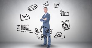 Digital composite image of businessman amidst various icons against gray background Royalty Free Stock Photos