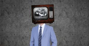 Digital composite image of businessman with damaged television in head. Digital composite of Digital composite image of businessman with damaged television in Stock Photos