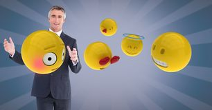 Digital composite image of businessman with emojis. Digital composite of Digital composite image of businessman with emojis Stock Photography