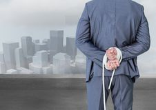 Digital composite image of a businessman with his hands tied behind the back Royalty Free Stock Images