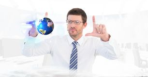 Digital composite image of businessman making hand frame while looking at globe Royalty Free Stock Images