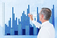 Digital composite image of businessman preparing bar graph. Digital composite of Digital composite image of businessman preparing bar graph Royalty Free Stock Image