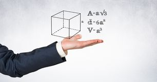 Digital composite image of businessman's hand with formulas and diagram. Digital composite of Digital composite image of businessman's hand with formulas and Royalty Free Stock Photography