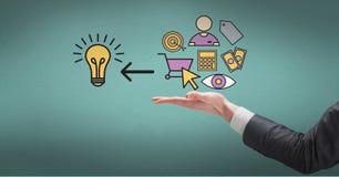 Digital composite image of businessman`s hand with idea icons. Digital composite of Digital composite image of businessman`s hand with idea icons Stock Photos