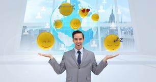 Digital composite image of businessman with various emojis against globe. Digital composite of Digital composite image of businessman with various emojis against Royalty Free Stock Photos