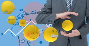 Digital composite image of businessmen holding flying emojis with tech graphics in background stock illustration
