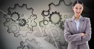 Digital composite image of businesswoman with gears in background royalty free illustration