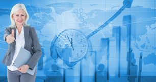 Digital composite image of businesswoman gesturing thumbs up standing against clock and graphs. Digital composite of Digital composite image of businesswoman Royalty Free Stock Photos