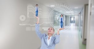 Digital composite image of businesswoman holding executives in hands with symbols. Digital composite of Digital composite image of businesswoman holding Stock Photography