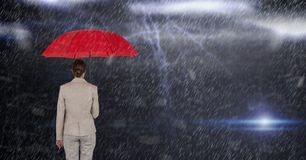 Digital composite image of businesswoman holding red umbrella while standing in rain Stock Photos