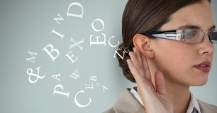 Digital composite image of businesswoman listening alphabets. Digital composite of Digital composite image of businesswoman listening alphabets Royalty Free Stock Image