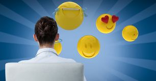 Digital composite image of businesswoman looking at emojis. Digital composite of Digital composite image of businesswoman looking at emojis Stock Photos