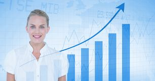 Digital composite image of businesswoman standing against graph showing growth. Digital composite of Digital composite image of businesswoman standing against Royalty Free Stock Photos