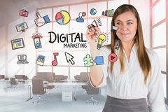 Digital composite image of businesswoman touching icons in office Stock Image