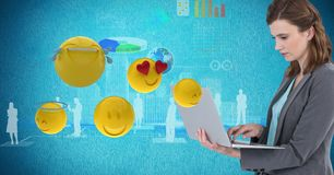 Digital composite image of businesswoman using laptop by various emojis. Digital composite of Digital composite image of businesswoman using laptop by various Stock Photography