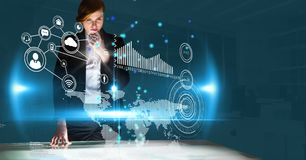 Digital composite image of businesswoman working on virtual screen Stock Photo