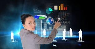 Digital composite image of confident businesswoman making plans on futuristic screen. Digital composite of Digital composite image of confident businesswoman Stock Photos
