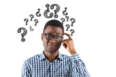 Digital composite image of confused businessman with question marks. Digital composite of Digital composite image of confused businessman with question marks Stock Images
