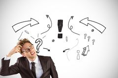 Digital composite image of confused businessman with question marks and arrow symbols in background. Digital composite of Digital composite image of confused Stock Photos