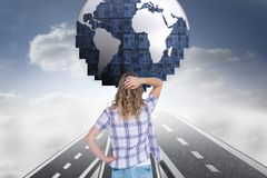 Digital composite image of confused woman looking at globe Stock Images