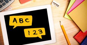 Digital composite image of digital tablet with alphabets and numbers Royalty Free Stock Images