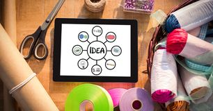 Digital composite image of digital tablet with idea sign by craft equipment Stock Image