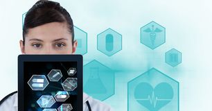 Digital composite image of doctor showing medical signs on tablet PC Stock Photos