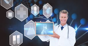 Digital composite image of doctor showing x-ray on screen over futuristic screen stock photos
