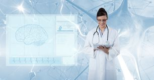 Digital composite image of doctor using tablet PC with screen in foreground Stock Images
