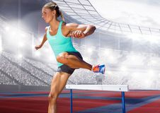 Digital composite image of female athlete jumping above the hurdle Stock Photos