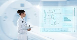 Digital composite image of female with clipboard analyzing human body with interface graphics. Digital composite of Digital composite image of female with Stock Photo