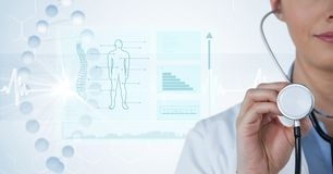 Digital composite image of female doctor with stethoscope by diagrams and graphs in background. Digital composite of Digital composite image of female doctor Royalty Free Stock Image
