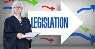 Digital composite image of female lawyer holding book while  standing against legislation text on ar. Digital composite of Digital composite image of female Royalty Free Stock Photography