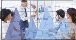 Digital composite image of graphs and grid with business people working in office. Digital composite of Digital composite image of graphs and grid with business Stock Photos
