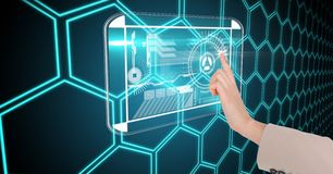 Digital composite image of hand touching futuristic screen with interface graphics Stock Image