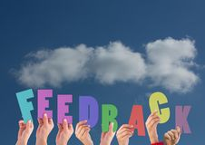 Digital composite image of hands holding feedback cutouts Stock Photography
