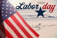 Composite image of digital composite image of happy labor day text with star shape. Digital composite image of happy labor day text with star shape against stock image