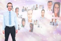 Digital composite image of HR executive wearing headphones by candidates Royalty Free Stock Image
