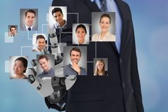 Digital composite image of HR`s robot hand selecting candidates. Digital composite of Digital composite image of HR`s robot hand selecting candidates royalty free stock photo