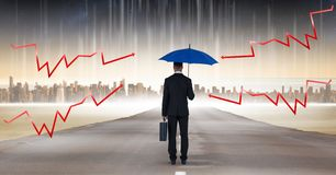 Digital composite image of lightning arrows on blue umbrella held by businessman with briefcase stan Royalty Free Stock Photos