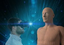 Digital composite image of man looking at 3d human figure through VR glasses. Digital composite of Digital composite image of man looking at 3d human figure royalty free stock photography
