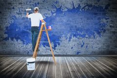 Digital composite image of man painting wall. Digital composite of Digital composite image of man painting wall Stock Photos