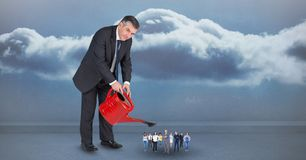 Digital composite image of manager watering employees against cloudy sky Stock Photography
