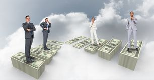 Digital composite image of people standing on money in sky. Digital composite of Digital composite image of people standing on money in sky royalty free stock image