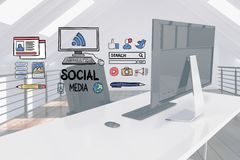 Digital composite image of social media signs over computer desk Stock Photo