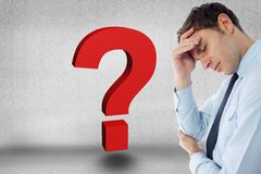 Digital composite image of tensed businessman by question mark against gray background Stock Image