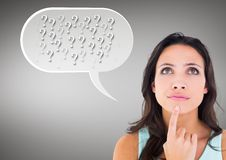 Digital composite image of thinking woman with speech bubble. Against grey background royalty free stock photo
