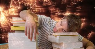 Digital composite image of tired student sleeping on books surrounded with equations stock photo