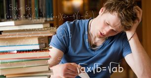 Digital composite image of various math equations by tensed college students studying at table in li. Digital composite of Digital composite image of various Royalty Free Stock Images