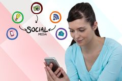 Digital composite image of woman using smart phone by various icons against colored background. Digital composite of Digital composite image of woman using smart Stock Image